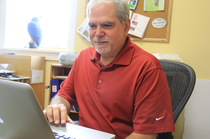 Volunteer and parent Toby Bray, pictured here in the Marketing Office while working on the new Greenspring Montessori website on the last day before its launch.
