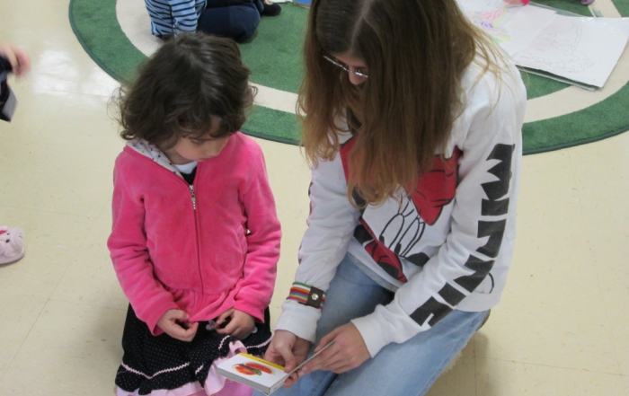 Adolescent Program Students Read to Children's House